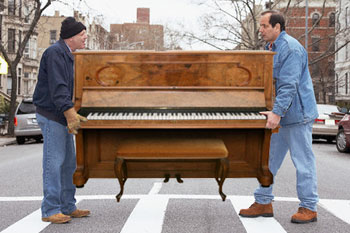 Image result for men carrying a piano pictures